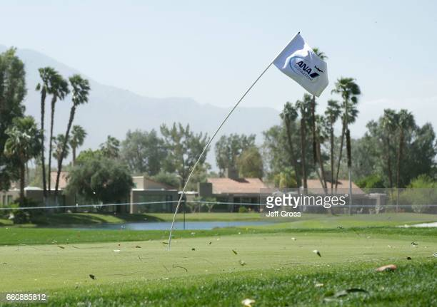 A flag is seen bending from the wind on the fourth green during the first round of the ANA Inspiration at the Dinah Shore Tournament Course at...