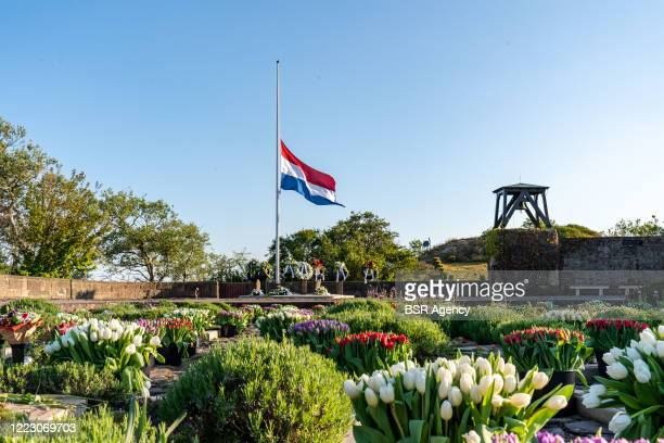A flag is seen halfmast at Honorary Cemetery Bloemendaal on May 4 2020 in Bloemendaal Netherlands during a sober commemoration of the dead at...