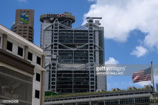 Flag is seen hoisted outside the US Consulate building , with a view of the local headquarters of both HSBC and Standard Chartered banks in Hong Kong...