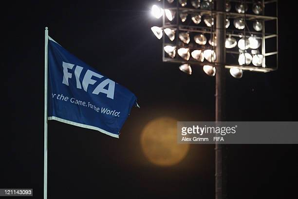 FIFA flag is seen in front of the full moon during the FIFA U20 World Cup 2011 quarter final match between Portugal and Argentina at Estadia Jaime...