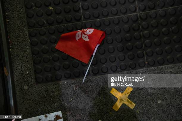 HKSAR flag is seen on the floor after a gang of stickwielding assailants assaulted commuters and protestors at the platforms of the Yuen Long MTR...