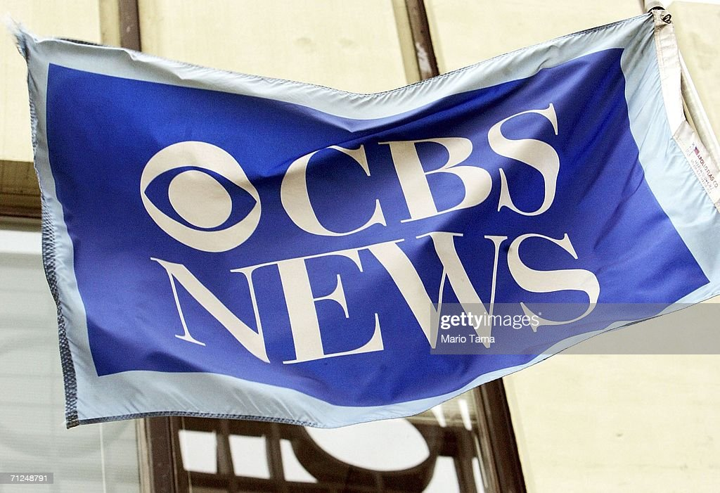 A flag is seen outside CBS News headquarters June 20, 2006 in New York City. CBS announced that Dan Rather is leaving the network after 44 years, following his departure as anchorman last year.