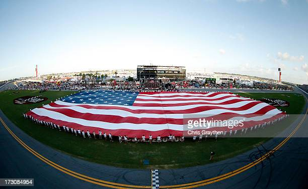 A flag is spread across the infield prior to the start of the NASCAR Sprint Cup Series Coke Zero 400 at Daytona International Speedway on July 6 2013...