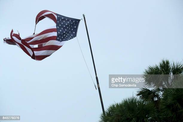 S flag is tattered by winds produced by Hurricane Irma September 10 2017 in Fort Lauderdale Florida The category 4 hurricane made landfall in the...