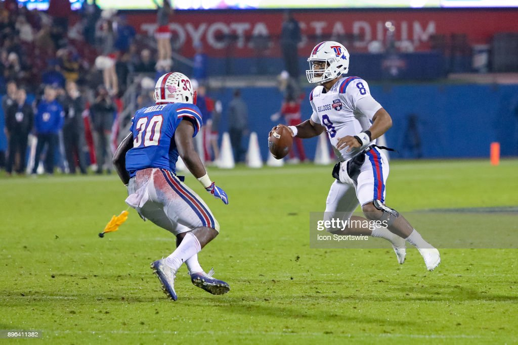 A flag is thrown while Louisiana Tech Bulldogs quarterback J'Mar Smith (8) scrambles away from Southern Methodist Mustangs linebacker Shaine Hailey (30) during the DXL Frisco Bowl game between the Louisiana Tech Bulldogs and SMU Mustangs on December 20, 2017 at Toyota Stadium in Frisco, TX.