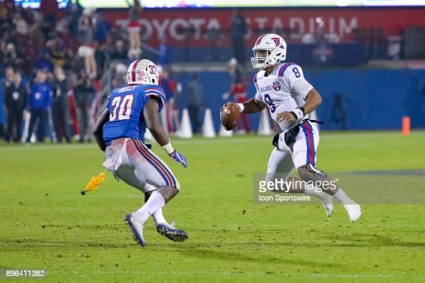 A flag is thrown while Louisiana Tech Bulldogs quarterback J'Mar Smith scrambles away from Southern Methodist Mustangs linebacker Shaine Hailey...
