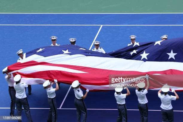 Flag is unfurled on the court ahead of the 2021 US Open Tennis tournament women's final match between Britain's Emma Raducanu and Canada's Leylah...