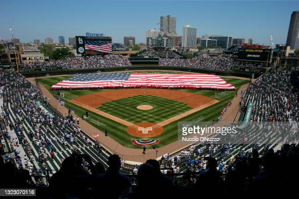 Flag is unfurled on the field prior to a game between the Chicago Cubs and the St. Louis Cardinals at Wrigley Field on June 11, 2021 in Chicago,...