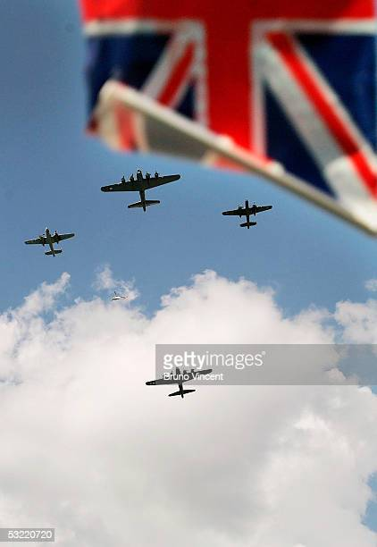 A flag is waved in front of part of the flypast during the 60th Anniversary of the end of World War II July 10 2005 in London Poppies were dropped...