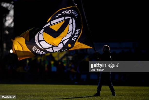 A flag is waved on the pitch prior to The Emirates FA Cup Third Round match between Newport County and Leeds United at Rodney Parade on January 7...