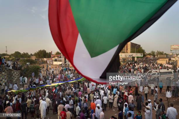 Flag is waved over the protest on May 03, 2019 in Khartoum, Sudan. Thousands of demonstrators continued their mass sit-in outside military...