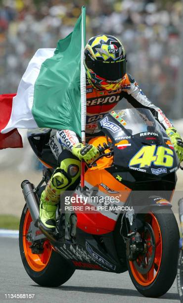 flag itMoto GP World Champion Italian Valentino Rossi holds his national flag after winning the Moto Grand Prix of Spain 11 May 2003 in Jerez Italian...