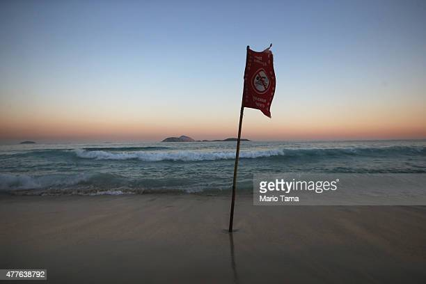 A flag marking dangerous currents flies at Ipanema beach on the Atlantic Ocean on June 18 2015 in Rio de Janeiro Brazil Pope Francis' encyclical on...