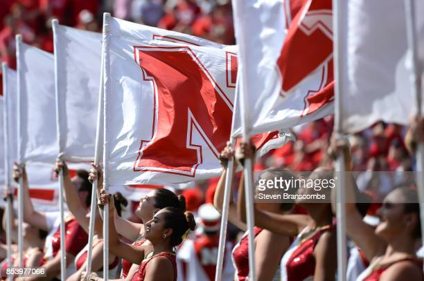 Flag members of the Nebraska Cornhuskers perform before the game against the Rutgers Scarlet Knights at Memorial Stadium on September 23 2017 in...
