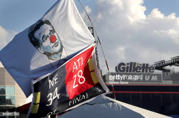 A flag mocking NFL Commissioner Roger Goodell flies over the tent of Patriots fan Chris O'Neil of Boston The New England Patriots host the Kansas...