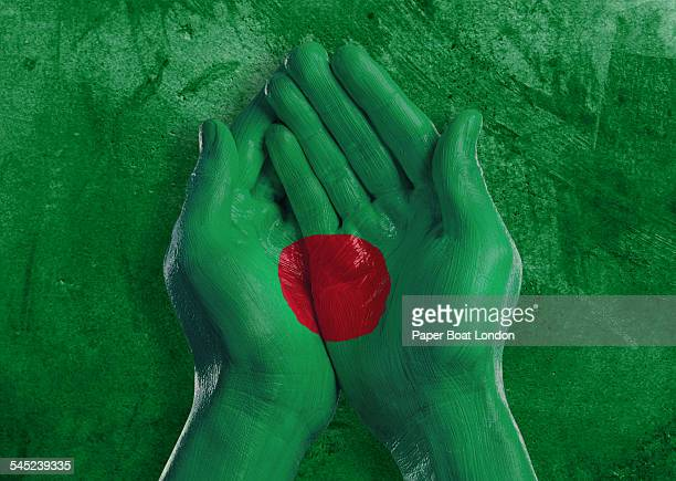 flag of bangladesh painted on two hands - bangladesh flag stock photos and pictures