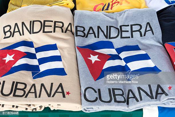 Flag of Cuba on two shirts along with Bandera Cubana which means flag of Cuba in their language This symbol is shown in two shirts as symbol of...