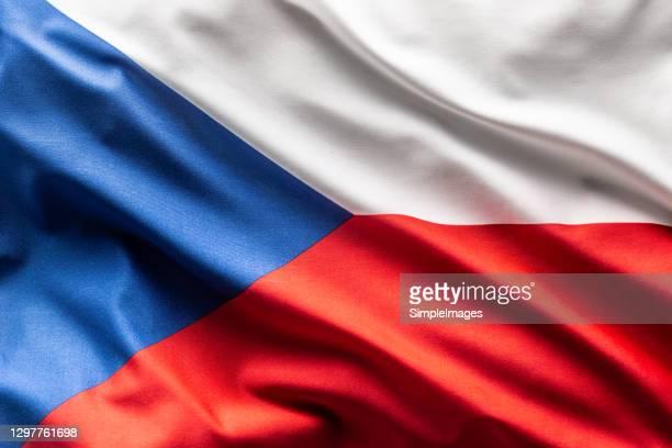 flag of czech republic blowing in the wind. - tsjechië stockfoto's en -beelden