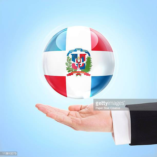 flag of dominican republic, supported by a hand - dominican republic flag stock pictures, royalty-free photos & images