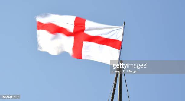 Flag of England in the sky on a sunny day with motion blur at Bristol England in August 5th 2017