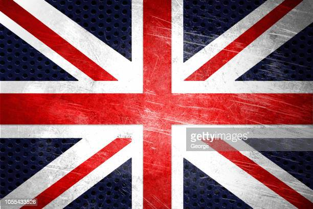 flag of england on a stainless steel surface - union jack stock photos and pictures