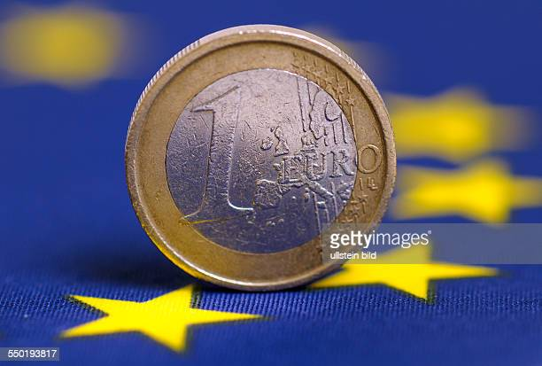 A flag of EU and a one Euro coin