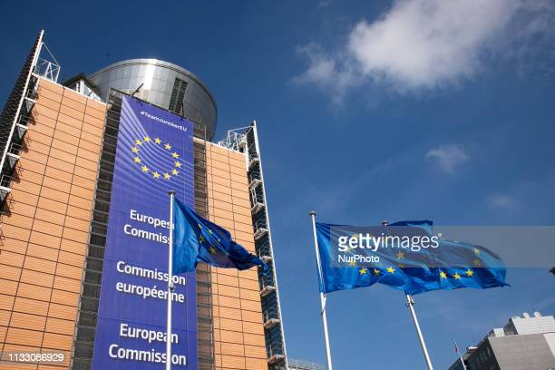 Flag of Europe in front of Le Berlaymont headquarters of the European Commission European Union EU The flag was designed by Arsène Heitz and Paul M G...