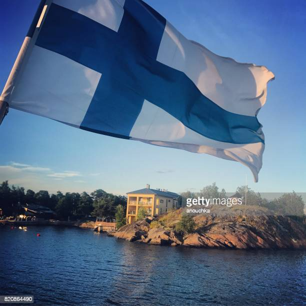 flag of finland on a ferry boat cruising around helsinki. - finnish flag stock photos and pictures