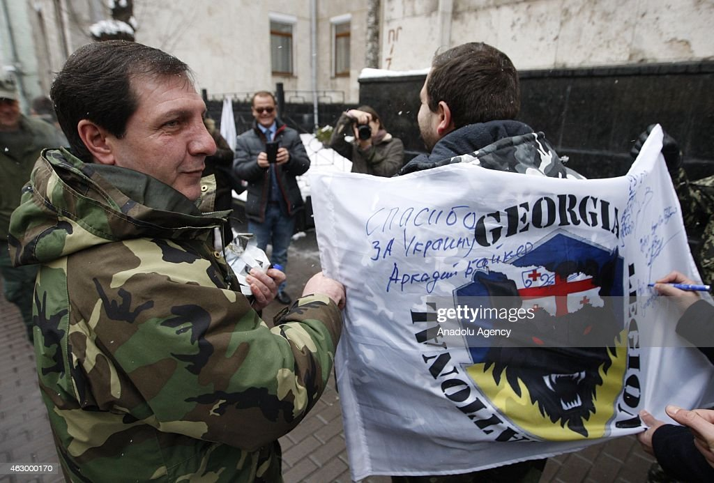Flag of Georgian legion is signed after a ceremony held for the 29 volunteer Georgian people fighting against the pro-Russian separatists, in Kiev, Ukraine on February 08, 2015. Volunteers are granted with an award for their sacrifices for Ukraine's peace during the ceremony.