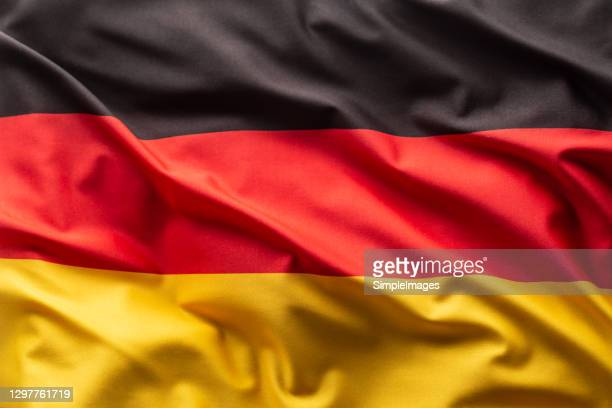 flag of germany blowing in the wind. - alemanha imagens e fotografias de stock