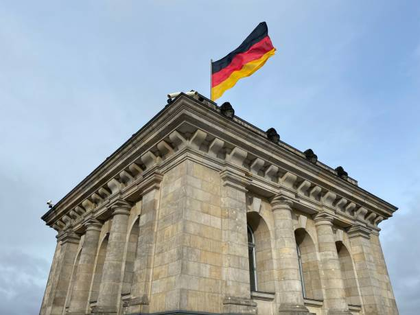 Flag of Germany blows proudly in the wind, on the Reichstag in Berlin.