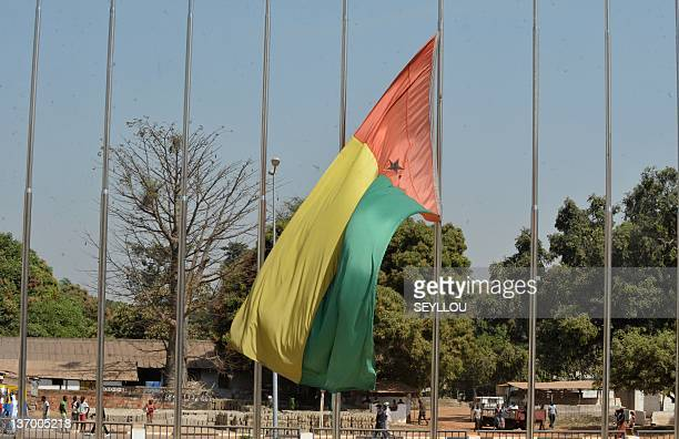 A flag of GuineaBissau flies at halfmast as the coffin of late President Malam Bacai Sanha who died in on January 9 2012 at a Paris hospital is...