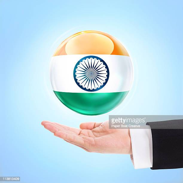 Flag of India being supported by a hand