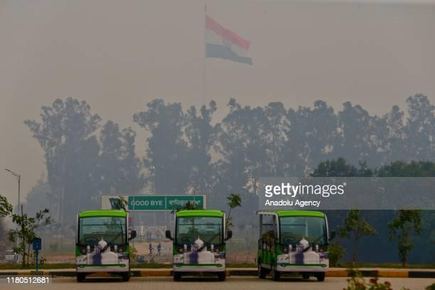 Flag of India is seen as buses are placed at Gurdwara Darbar Sahib Kartarpur shrine where the Sikhism founder Guru Nanak Dev died in Kartarpur town...