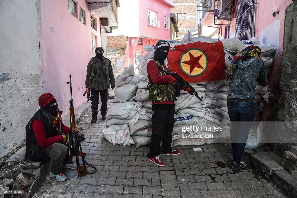 A flag of Kurdish workers Party (PKK) hangs on a barricade as armed kurdish militants man a barricade, on November 18, 2015 in the Sur district of Diyarbakir. Tensions rose when pro-Kurdish MP Leyla Zana began her oath with 'Biji Asiti', or 'Long live peace' in Kurdish. The phrase triggered a storm that recalled her memorable swearing-in 24 years ago when she also spoke the language that was then still taboo in public.