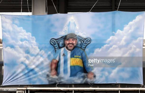 Flag of late football legend Diego Maradona hangs on the stands of the stadium during a match between Boca Juniors and River Plate as part of Copa De...