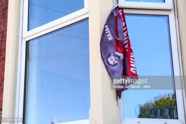 Flag of Mohamed Salah of Liverpool hangs from a window outside a house prior to the Premier League match between Liverpool FC and Wolverhampton...