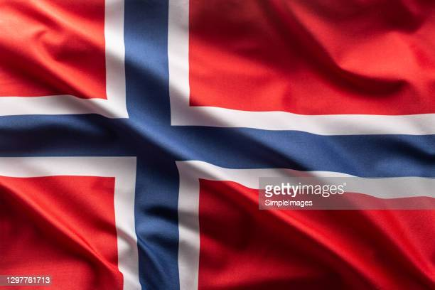 flag of norway blowing in the wind. - norwegian flag stock pictures, royalty-free photos & images