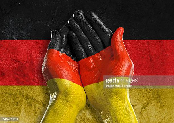 Flag of  painted on two hands together