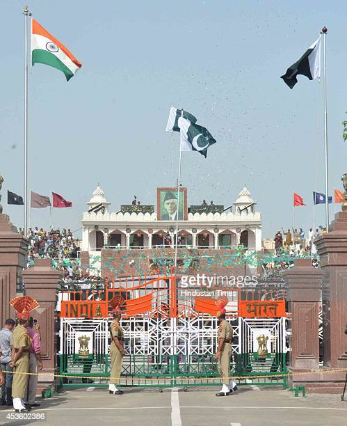Flag of Pakistan hoisted at the IndiaPakistan Wagah border post on occasion of Pakistans 68th Independence Day on August 14 2014 near Amritsar India