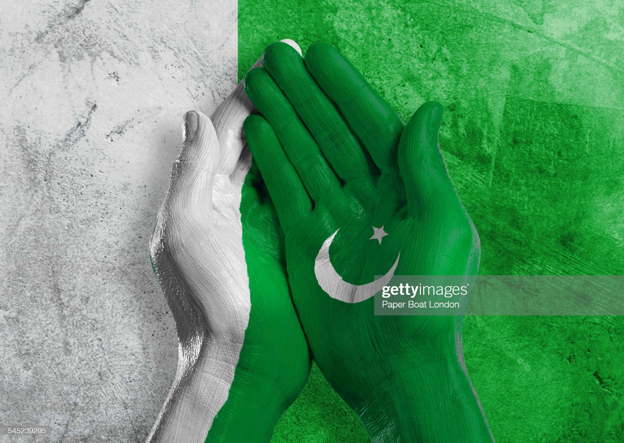 Flag of Pakistan painted on two hands together : Stock Photo