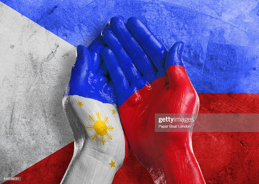 Flag of Philippines painted on two hands : Stock Photo