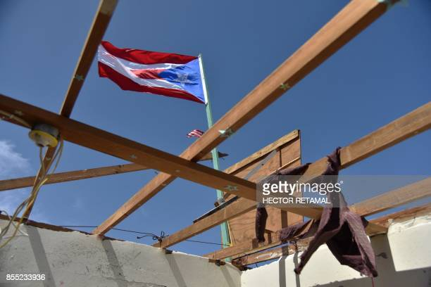 A flag of Puerto Rico is seen of the damaged house of Javier in Yabucoa in the east of Puerto Rico on September 28 2017 The US island territory...