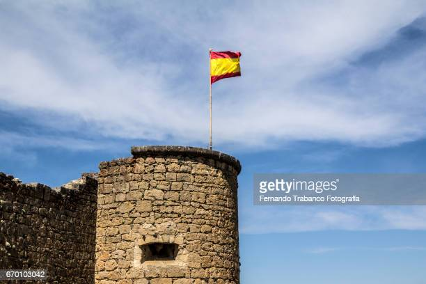 Flag of Spain to the wind in a stone tower (public building, no ticket, free)