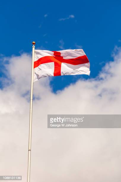 flag of st george in blue sky #3 - bandiera inglese foto e immagini stock