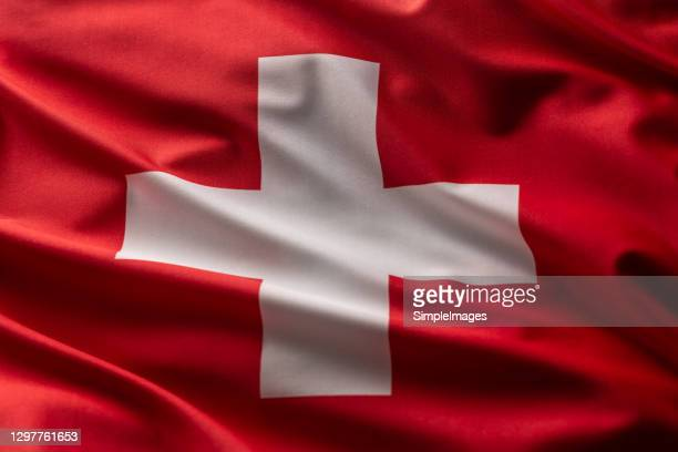 flag of switzerland blowing in the wind. - country geographic area stock pictures, royalty-free photos & images