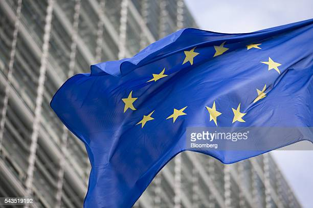 A flag of the European Union flies outside the European Commission building in Brussels Belgium on Tuesday June 28 2016 UK Prime Minister David...
