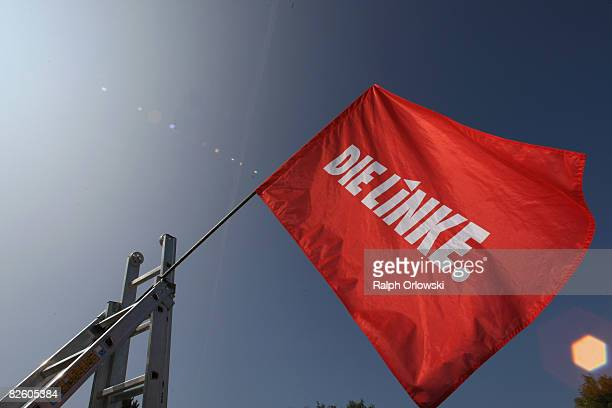 A flag of the far leftwing party Die Linke waves in the wind during a party congress on August 30 2008 in Lollar Germany Die Linke party of Hesse...