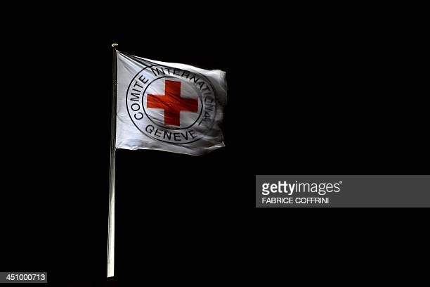 A flag of the International Committee of the Red Cross floats on the top of the ICRC headquarters on late November 20 2013 in Geneva AFP PHOTO /...