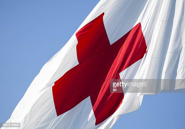 flag of the international red cross - cruz roja fotografías e imágenes de stock